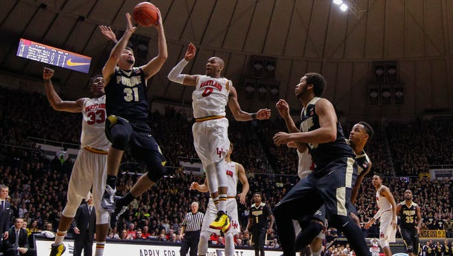 Dakota Mathias of the Purdue Boilermakers shoots the ball against Rasheed Sulaimon #0 of the Maryland Terrapins at Mackey Arena on February 27, 2016 in West Lafayette, Indiana.