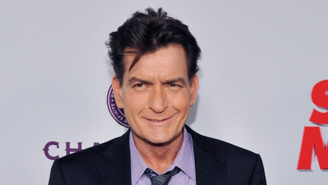 A judge lifted a restraining order against Charlie Sheen on Thursday.