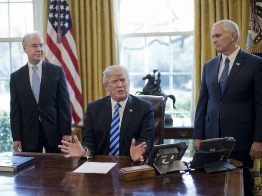 In this file photo, President Donald Trump, flanked by Health and Human Services Secretary Tom Price, left, and Vice President Mike Pence, right, speaks about the health care overhaul bill, Friday, March 24, 2017, in the Oval Office of the White House in Washington. (AP Photo/Pablo Martinez Monsivais)