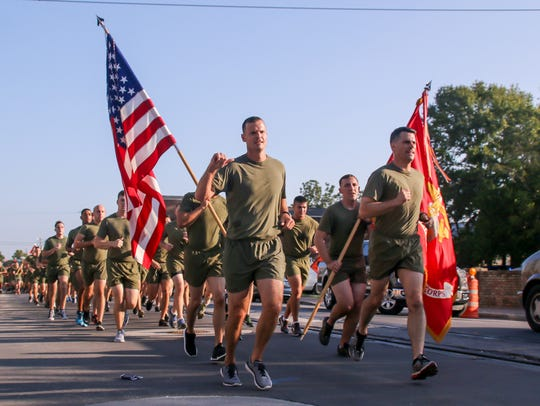 Runners make their way through downtown Pensacola during the 34th annual Semper Fi 5K charity run. This year's run is set for Saturday.