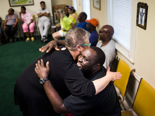 Becky Walker hugs Wendel Brown at the deaf ministry on Wednesday at North Anderson Baptist Church.