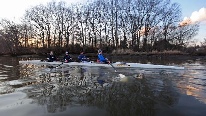oseph Stockburger (from left), 18, Nicholas Malchione, 17, Phil Claudy, 17, and Mike Glaude, 17, all seniors at Salesianum, row last month with the Newport Rowing Club during practice on the Christina River. Much of the river fails to meet Clean Water Act requirements for swimming.