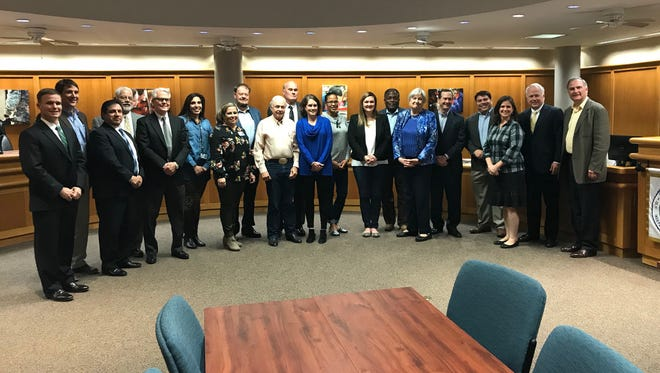 Long Range Facilities Planning Committee and San Angelo ISD school board of trustees pose for a photo during Monday night's board meeting, Jan. 22, 2018.