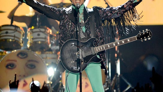 Musician Prince performs onstage during the 2013 Billboard