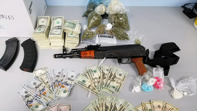 Indianapolis police arrested five adults and seized a quantity of drugs, weapons and cash in a raid on a home in the 1300 block of North Berwick Avenue on Indianapolis' west side.