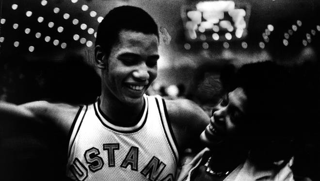 Manuel Forrest got a hug from his mother, Lurlene, after he and his Moore High School teammates defeated Oldham County in the 1980 state basketball tournament. Forrest scored 27 points, blocked seven shots and gathered 17 rebounds.