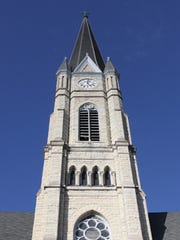 St. Michael's thin spire rises into a sunny blue sky.