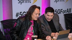 T-Mobile CEO John Legere (left) and Sprint Executive Chairman Marcelo Claure