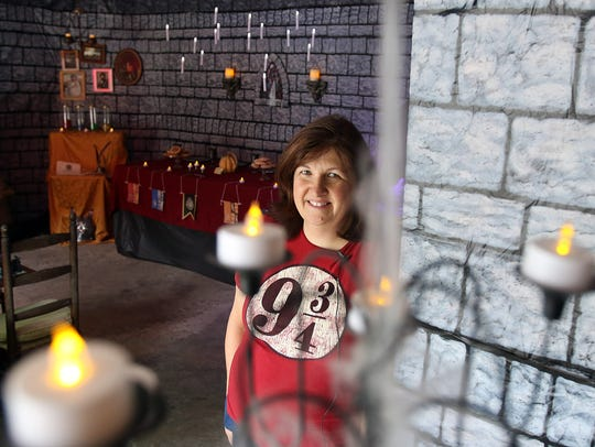 Dody Marriott decorates her garage at her home on Capitol