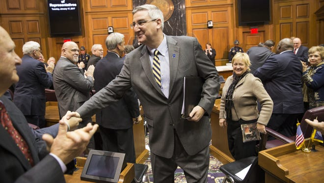 Indiana Governor Eric Holcomb works the floor after giving his first State of the State address inside the Indiana House of Representatives.
