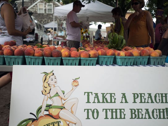 Bennett Orchards offers fresh peaches to patrons shopping