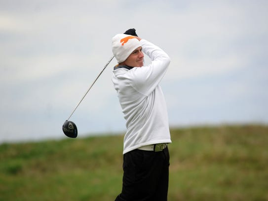 Unioto's Peyton Cooper tees off during the Division