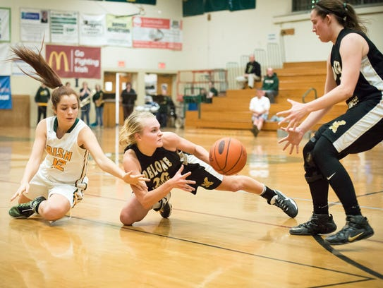 Delone's Katie Laughman (center) held Kate Bauhof (left)