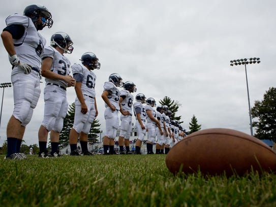 Marysville players line up before a football game Thursday,