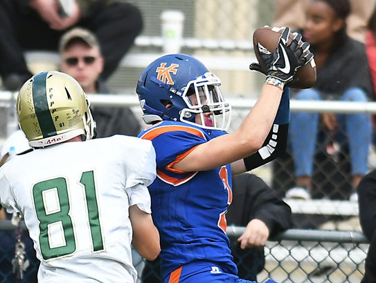 Keansburg's Joe Osterbye grabs a pass in the 2nd quarter