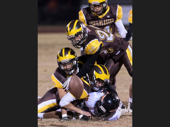 Golden West defenders go after a fumble against McClymonds