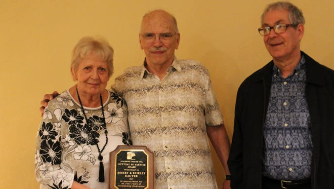 Shirley Rauter, left, and Robert Rauter, along with their son, Don Skrobuton, pose for a photo after being awarded the Lifetime of Service award by the Sunshine House Monday, May 1, 2017.