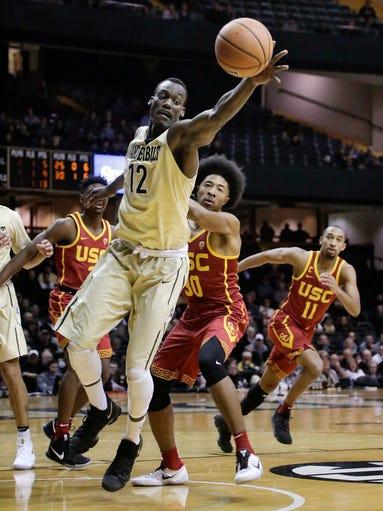 Vanderbilt center Djery Baptiste (12) pulls in a rebound