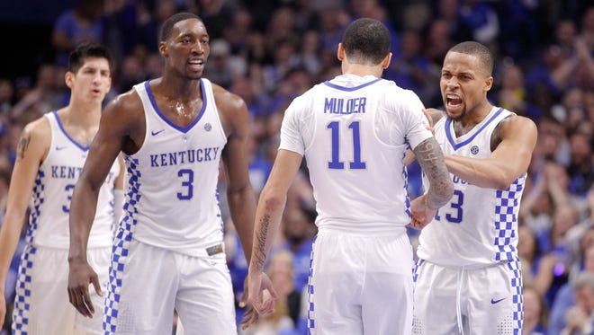 Kentucky Wildcats guard Mychal Mulder (11) celebrates with guard Isaiah Briscoe (13) and forward Edrice Bam Adebayo (3) during the game against the Vanderbilt Commodores in the first half at Rupp Arena on Feb. 28.