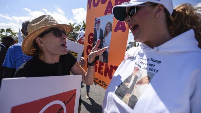WEST PALM BEACH -- Gun control advocate Liz Hughes of Palm Beach, left, exchanges shouts with Jennifer Eady of Wellington at the corner of Southern Boulevard and South Flagler Drive during a March for Our Lives demonstration in March 2018.