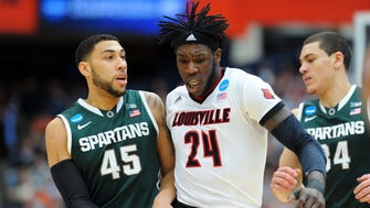 Mar 29, 2015; Syracuse, NY, USA; Louisville Cardinals forward Montrezl Harrell (24) runs into Michigan State Spartans guard Denzel Valentine (45) during the first half in the finals of the east regional of the 2015 NCAA Tournament at Carrier Dome. Mandatory Credit: Rich Barnes-USA TODAY Sports ORG XMIT: USATSI-221700 ORIG FILE ID:  20150329_pjc_ai8_011.JPG