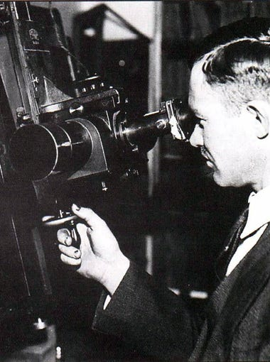 Lowell Observatory assistant  Clyde Tombaugh uses the Zeiss Blink Comparator to search for the ninth planet in the solar system. The photo is circa 1930.