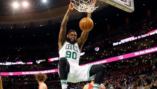 Boston Celtics forward Amir Johnson (90) dunks against the Chicago Bulls during the first quarter at TD Garden.