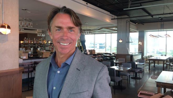 Chef John Besh, whose company will oversee the food and beverage service at the Thompson Hotel, overlooks the top-floor bar a week before opening.