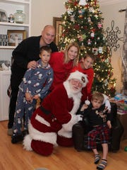 The Carr family celebrates its last Christmas with their youngest member, Chad, who died Nov. 23, 2015, at the age of 5. Show here are Jason Carr (left), CJ Carr, Tammi Carr, Santa Claus, Tommy Carr and Chad Carr.