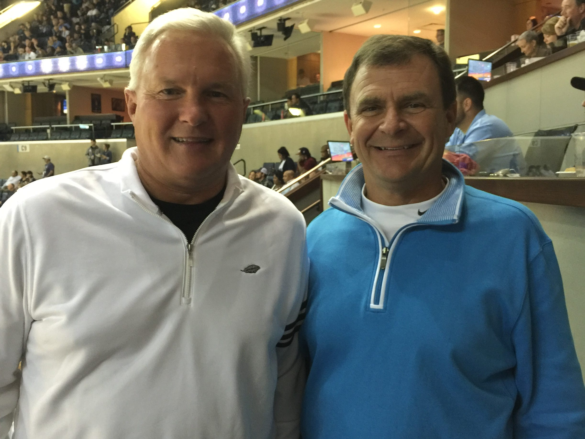 Current Brentwood Academy coach Hubie Smith, right, and Briarcrest coach John Harrington watched Brandan Wright make his debut with the Memphis Grizzlies on Wednesday.
