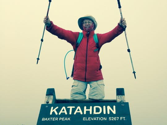 Jill Byrd celebrates reaching  the summit of Mt. Katahdin,