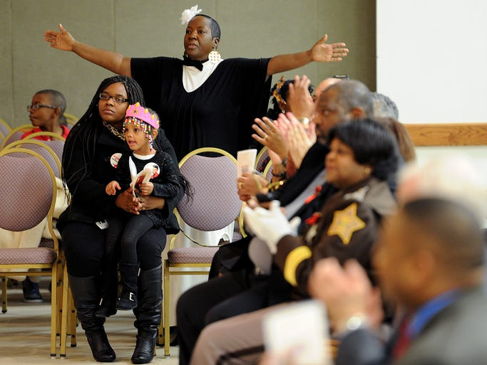 Families listen to the speakers during the 7th annual Light the Night for Life service at Purpose of Life Ministries, Tuesday, January 21, 2014. The service is part of the Global Week of Prayer for Christian Unity.