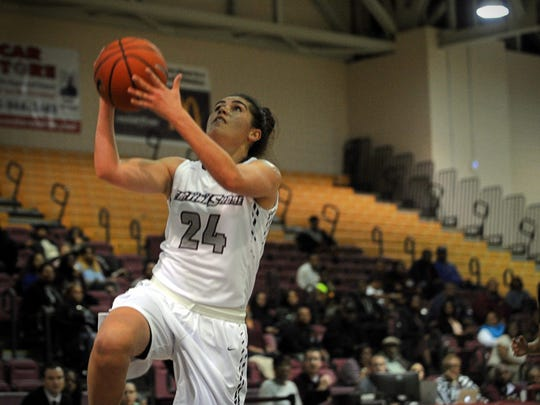 Hawks' forward Moengaroa Subritzky lays the ball up during a fast break on Tuesday, Nov. 29, 2016, during a game against UNCG in the Hytche Center.