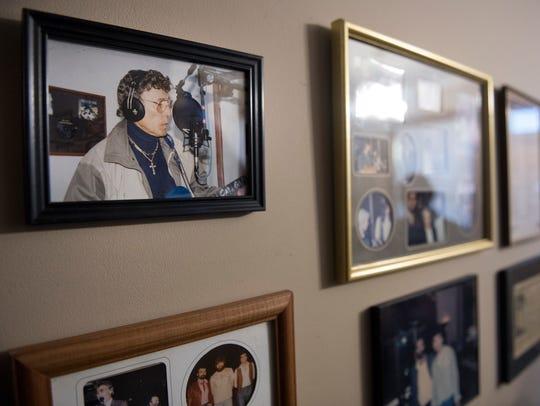 A framed photograph of music legend Carl Perkins hangs