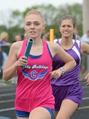 Centerville's Ashley Toschlog, left, and Hagerstown's Paige Gray run the 4x800m relay during the TEC Track and Field meet Thursday, May 14, 2015, at Northeastern in Fountain City.