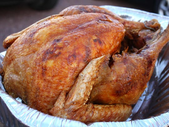 Deep-fried 16-pound turkeys are fried the morning of