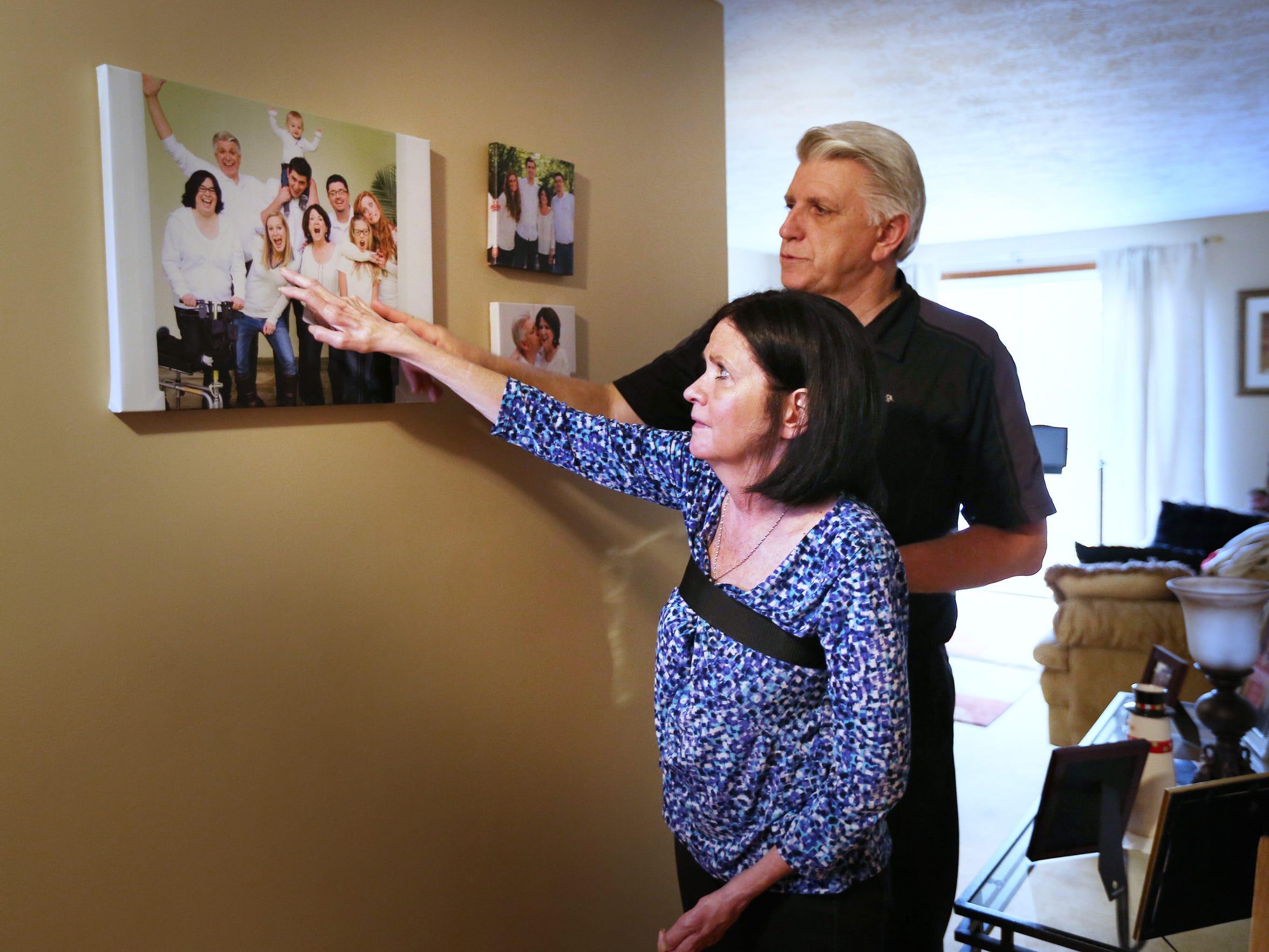 Maureen and Jim Burakiewicz look at a fun family photo