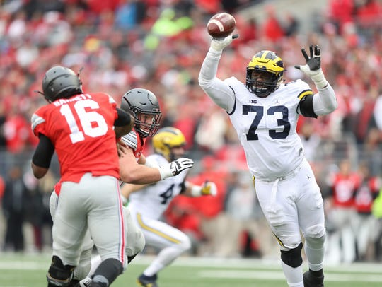 Michigan defensive tackle Maurice Hurst and the rest of Michigan's defense will hope to stop Ohio State on Saturday.