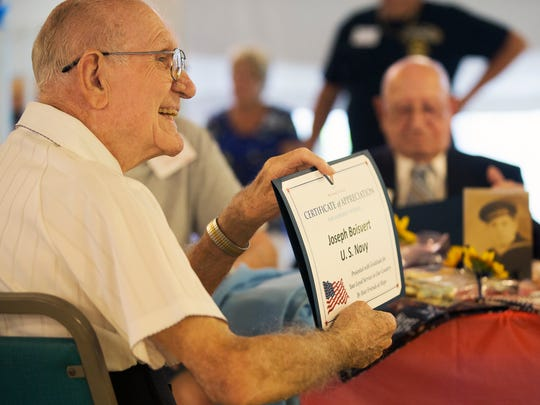 Joseph Boisvert was among 12 WWII veterans honored Sunday by residents of Forest Park Mobile Home Park in North Fort Myers. Boisvert served in the Navy. The veterans were given certificates of appreciation, U.S. Flag lapel pins, quilts and other items. The event was hosted by the Forest Park Craft Club with assistance from the Honor Guard for Hope HealthCare.