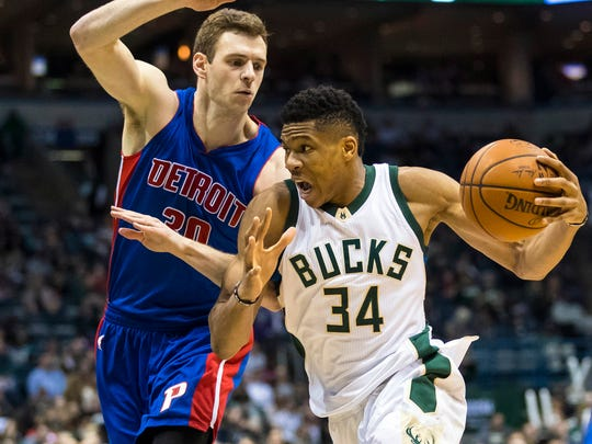 Mar 31, 2017; Milwaukee, WI, USA; Bucks forward Giannis Antetokounmpo drives for the basket as Pistons forward Jon Leuer defends during the third quarter at BMO Harris Bradley Center.