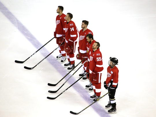 The Red Wings line up for the national anthem before