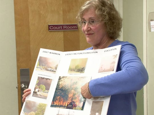 Brighton at Barnegat resident Diane Schlagel displays photos Thursday, May 11, 2017, that show the evacuation from her community during the Warren Grove fire 10 years ago.  On Thursday, firefighters, officials and residents met at the Barnegat Municipal Building to discuss how the community has changed in the 10 years since and how fire prevention efforts enroll the help of local residents.