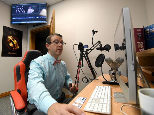Dan Jones edits his flipped classrooms videos from his work station in his new lab and studio.