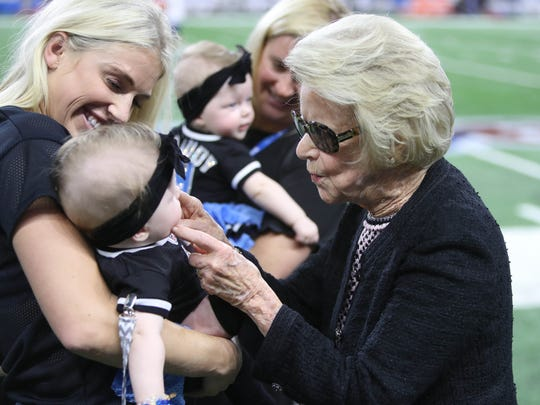 Lions owner Martha Ford plays with Sawyer Stafford while her mother Kelly Stafford holder her before the game against the Falcons, Sunday, Sept. 24, 2017 at Ford Field.