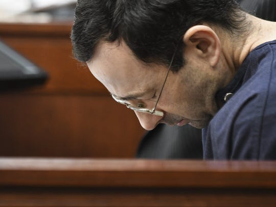 Larry Nassar hangs his head as former gymnast Amanda