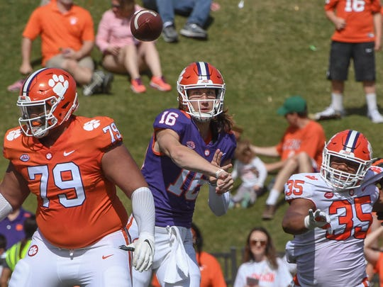 Clemson quarterback Trevor Lawrence (16) passes near