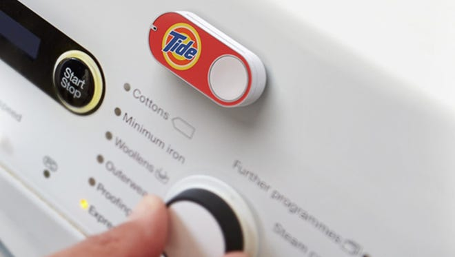 Amaon's Dash button, a small device that customers can stick near frequently-purchased items. Pressing the button automatically buys more of the item, in this case Tide laundry detergent.