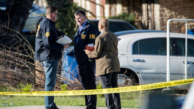 Law enforcement authorities investigate after multiple explosions in Austin, Texas, on March 12, 2018. Police say there are similarities between three package explosions that have killed two people and injured two others in two weeks.