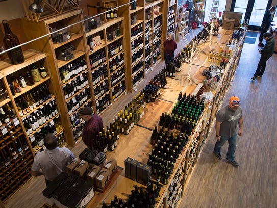 Customers browse the shelves at Square Beverage on
