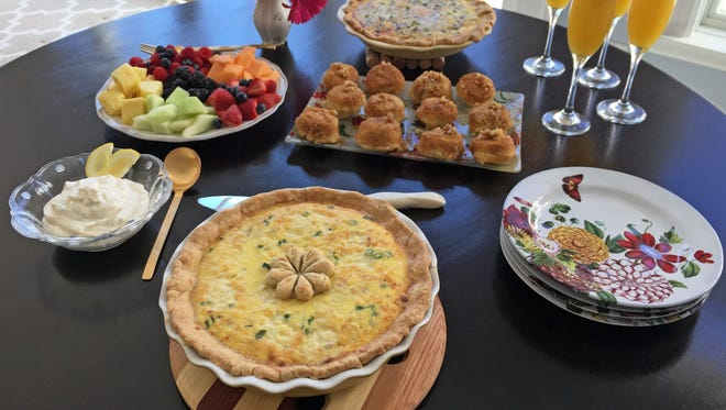 A flavorful homemade quiche, sweet butterscotch buns and fruit with yogurt sauce need only mimosas to make a company-worthy brunch.